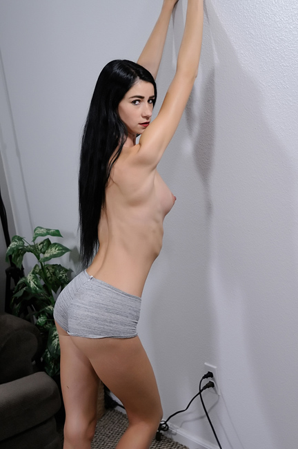 topless female model with long, black hair