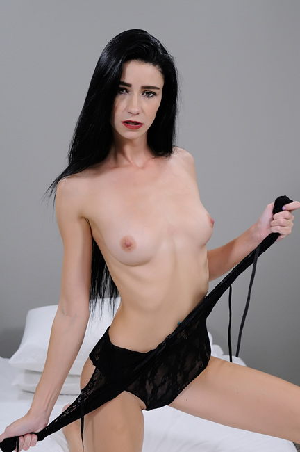 raven haired female standing topless in black lace lingerie
