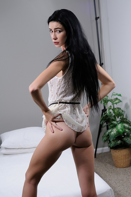 beautiful raven haired model showing her skinny ass from behind
