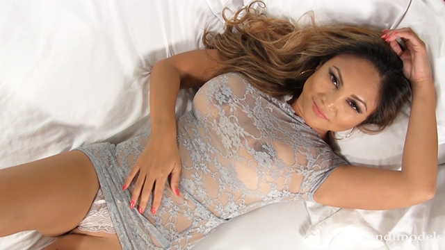 asian female model wearing see-through lace lingerie on the bed